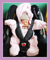 Photo of a small child in a car seat.