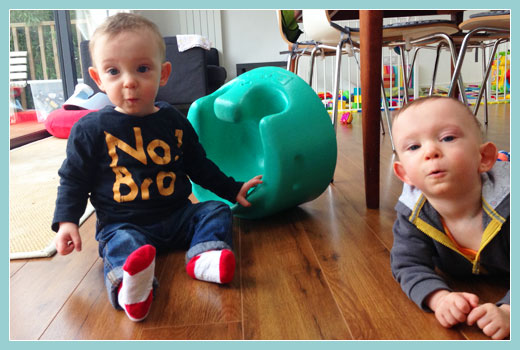Image of Heynan twin brothers several years old - both happy and healthy